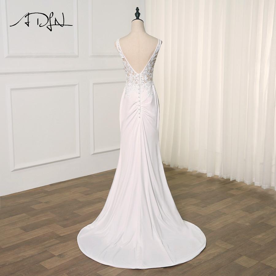 Großhandel Großhandel Sexy Meerjungfrau Hochzeitskleid V Ausschnitt  Sleeveless Sweep Zug Elasitc Brautkleider Applique Perlen Robe De Mariage  Von