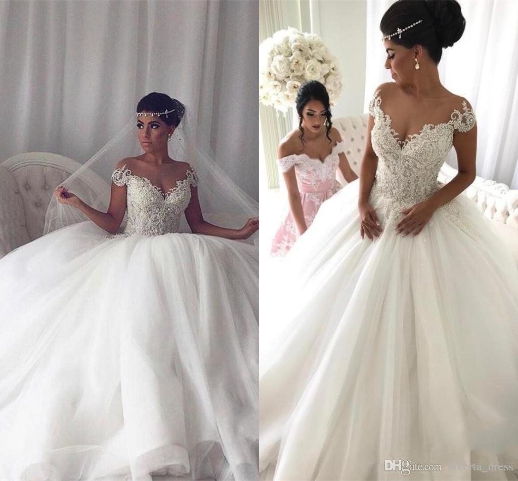 Großhandel Neueste Kurze Ärmel Ballkleid Brautkleider Perlen Reißverschluss  Zurück Tüll Brautkleider Prinzessin Plus Size Appliques Braut Brautkleider