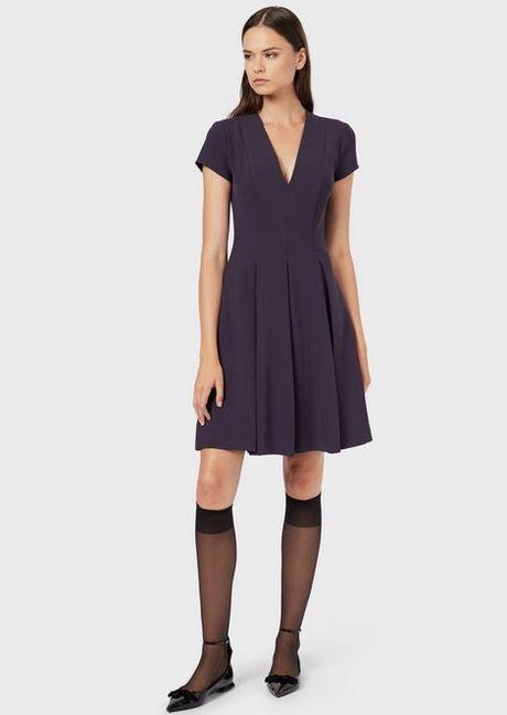 Schwarzes Enges Kleid Mit Langen Ärmeln