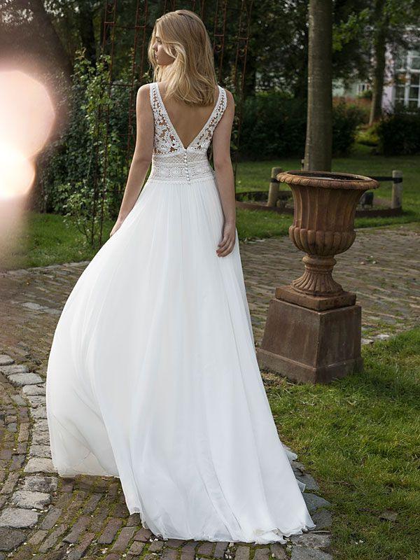 Spitzenbesetztes Brautkleid Im Vintagestil Mit Fließendem